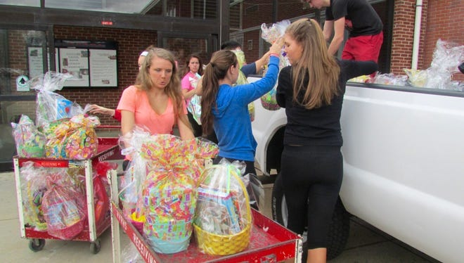 Rancocas Valley High School students load Eastern baskets onto a truck.They were made for sick children.