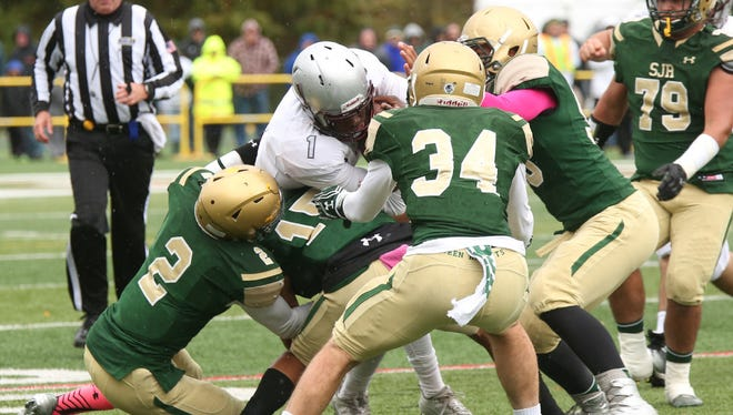 Louis Acceus (No. 2) makes a tackle for St. Joseph Regional in a regular season game against St. Peter's Prep.