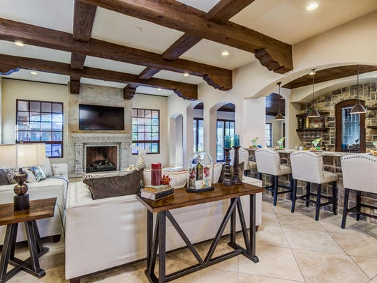 Jeremy Freer, a former CEO of Angel MedFlight, and his wife, Teresa, creative director at Runway Light LLC, purchased this 7,277-square-foot mansion in Paradise Valley's Cheney Ranch community.