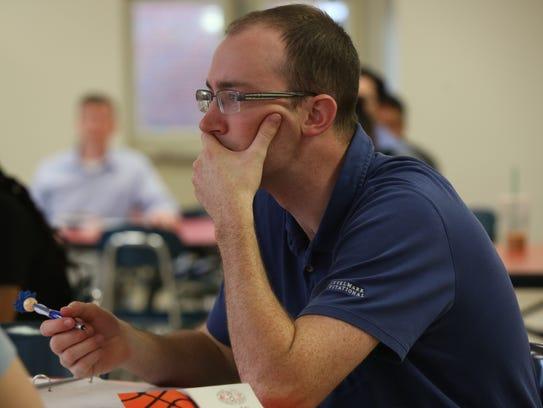 John Barbezat takes notes during a training session