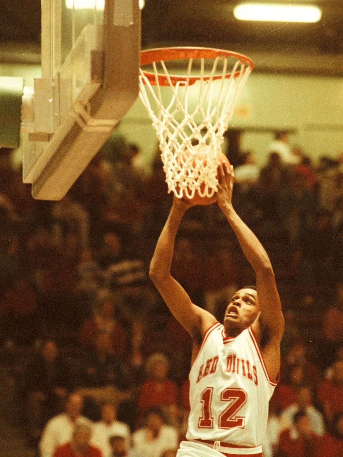 Richmond High School graduate Billy Wright, puts up a layup in a basketball game in 1992.