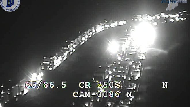I-65 was closed in all lanes after separate crashes Friday evening.