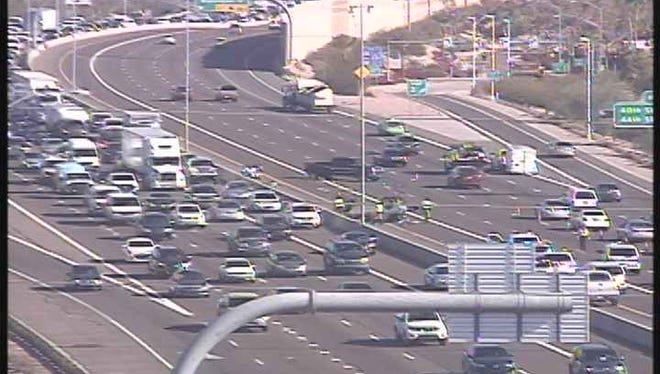 A wreck forced the closure of the eastbound lanes of Loop 202 in Phoenix on Dec. 15, 2015.