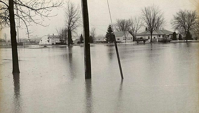 This 1980 photograph shows flooding on Old Manitowoc Road in Menasha.