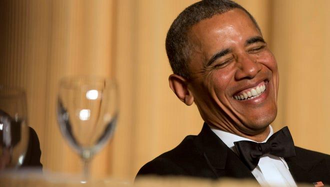 President Barack Obama laughs at the 2014 White House Correspondents' Association Dinner.
