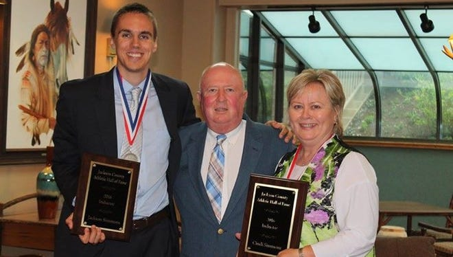 The mother-son combination of Cindi Simmons and Jackson Simmons joined Jackson County's athletic hall of fame last weekend.