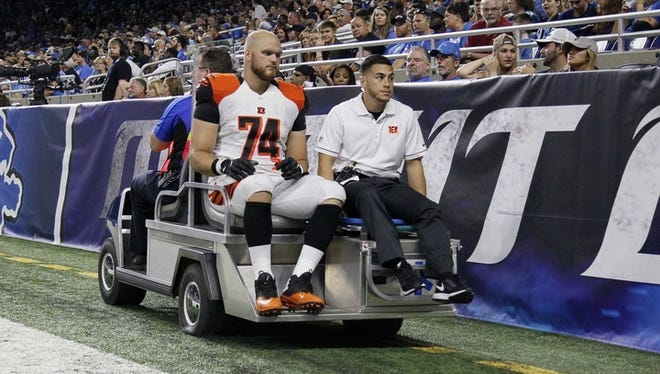 Bengals offensive lineman Jake Fisher is carted off Thursday night with a right leg injury.