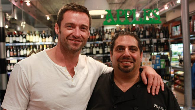 Actor Hugh Jackman (left) is one of several celebrities that chef Carl Hakim has catered to over the years.