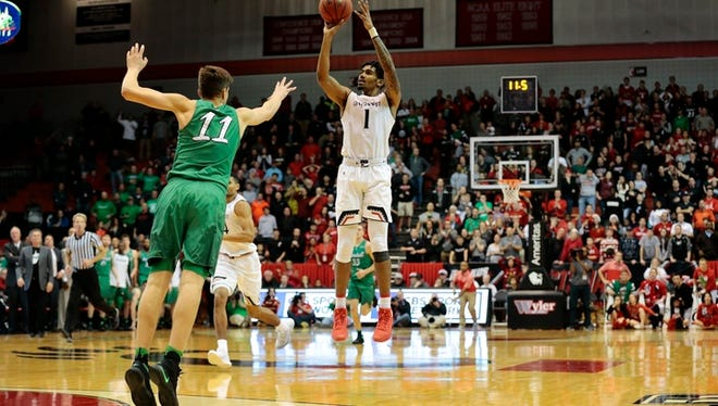 The Bearcats' Jacob Evans III hits a 3-pointer with 10 seconds left in regulation to send the game to overtime on Thursday at Fifth Third Arena.