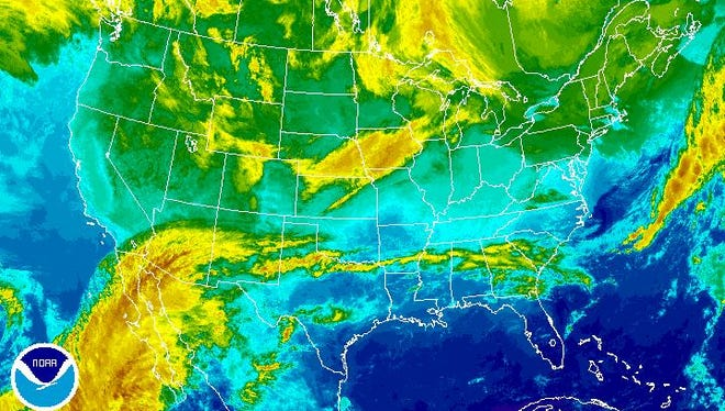A satellite image Wednesday, from the National Oceanic and Atmospheric Administration, shows clouds and subtropical moisture moving into southern New Mexico.