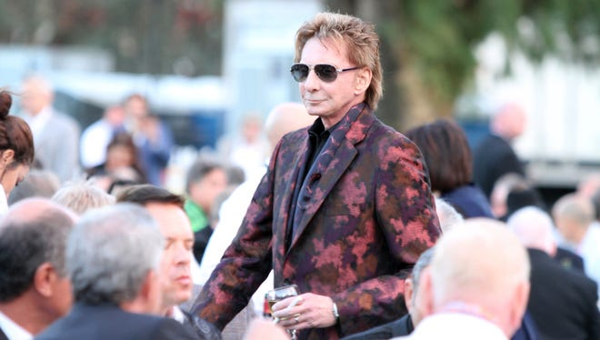 Barry Manilow walks to his seat during the 24th Annual Evening Under the Stars in Palm Springs on Saturday, May 6, 2017.