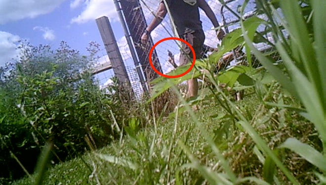 This security camera image shows Jeffrey S. Weigle waving a handgun moments before Dean Keller fired his own handgun at Weigle on June 27, 2017. Weigle fired back. Johnson County Prosecutor Brad Cooper announced Wednesday that shots were fired in self-defense and no charges would be filed.