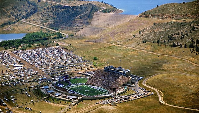 Don Reichert An aerial view of Hughes Stadium with Dixon (left) and Horsetooth (top) reservoirs in the background. An aerial view of Hughes Stadium with Dixon (left) and Horsetooth (top) reservoirs in the background.