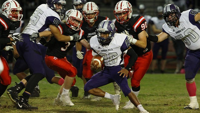 Shadow Hills player tries to gain yardage against Palm Springs during a high school football game Friday night,