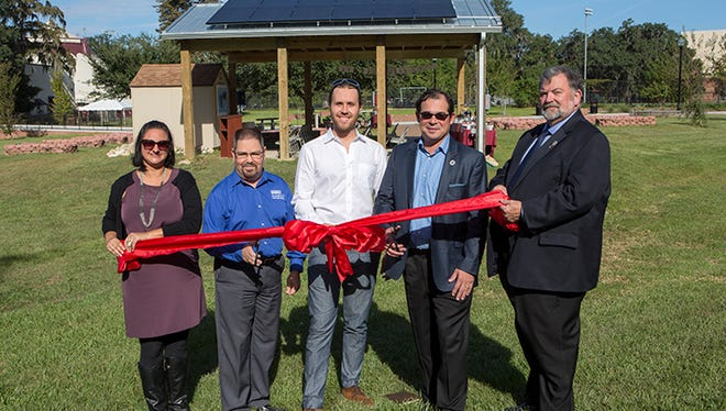 Sustainability Hub ribbon-cutting ceremony with, from left, Elizabeth Swiman, Scott Minos, Justin Vandenbroeck, Chris Diaz and Dennis Bailey.