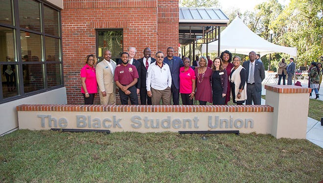 FSU President John Thrasher joins alumni and current students Friday at opening of new Black Student Union on campus.