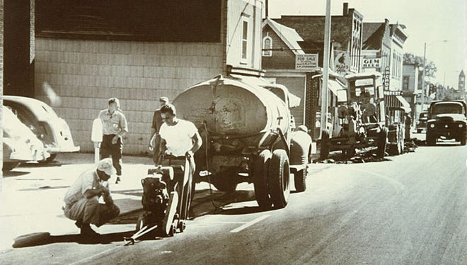 This south facing photograph shows road construction on the east side of Neenah's North Commercial Street in the 1950s.