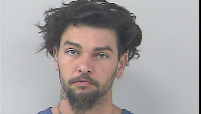 Michael Hazy, 30, was arrested, accused of entering a home in Port St. Lucie and snooping through a bag on March 17.