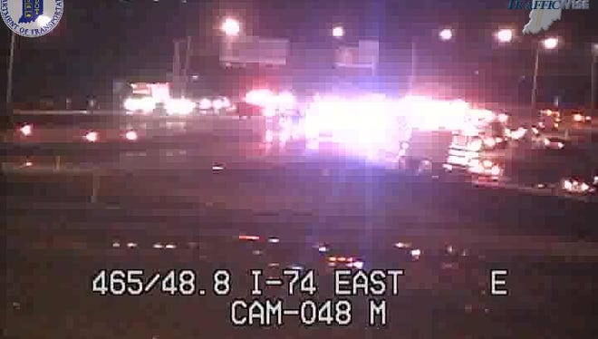 All lanes of I-74 near I-465 on the city's southeast side were closed following a crash involving a rolled-over semi on May 1, 2018.
