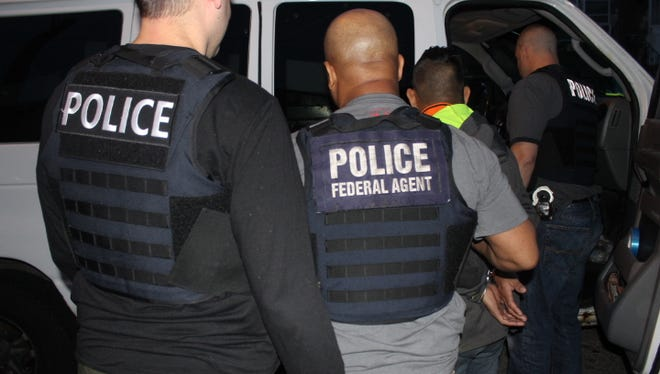 Immigration officers detain suspects in an operation targeting immigration violators in the Philadelphia area from May 14-20.