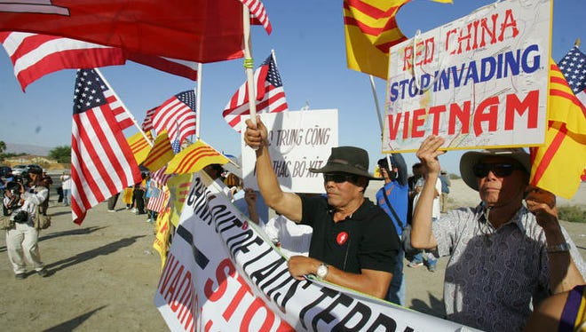Protesters oppose a meeting of President Barack Obama and Chinese President Xi Jinping at Sunnylands in 2013.