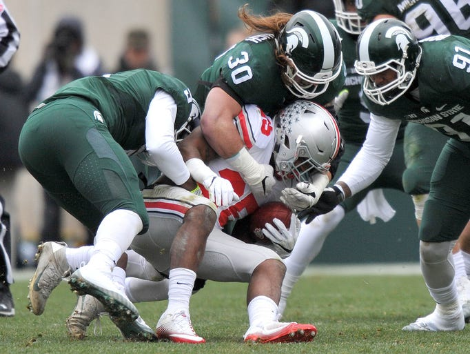 The Michigan State defense stops Buckeye Mike Weber