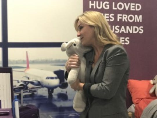 Columnist Jennifer Jolly with Parihug Plushies, which