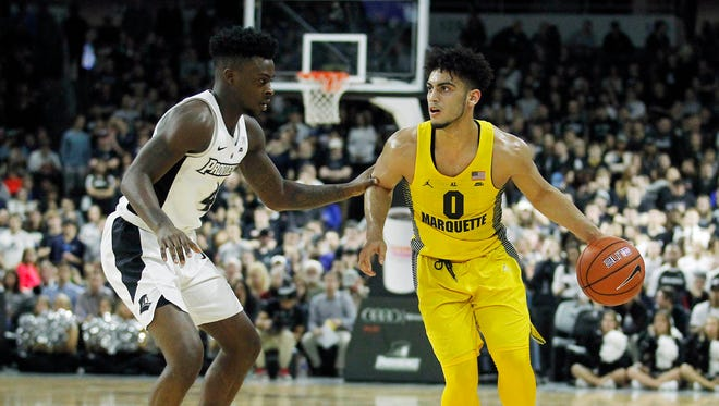 Providence Friars guard Maliek White (4) defends Marquette Golden Eagles guard Markus Howard (0) during the second half at Dunkin' Donuts Center.