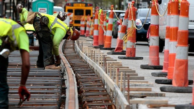 Construction continues Tuesday on the streetcar tracks along Main Street near Central Parkway in Over-the-Rhine.