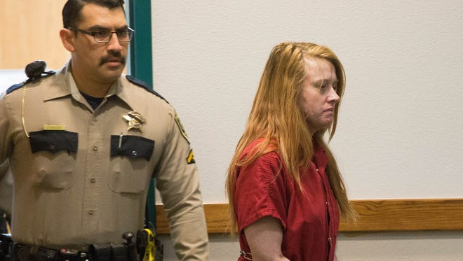 Trista Schlaefli, one of the suspects in a car chase that killed retired Las Cruces Police Officer J.R. Stewart walking into the 3rd Judicial District Court. Friday Dec. 1, 2017, where she and Daniel Lowell the other suspect in the incident are ordered to be held without bond pending trail.
