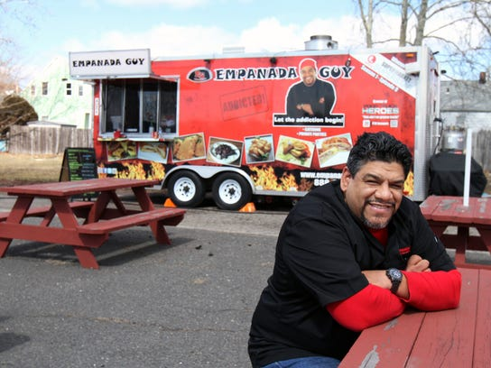 Carlos Serrano, aka The Empanada Guy, who owns several food trucks plus a free-standing restaurant in Freehold, sits outside one of his food trucks in the Port Reading section of Woodbridge. Empanada Guy will participate in several summer festivals, including the Union County Food Truck Festival on June 2 at Wine Library, Springfield.