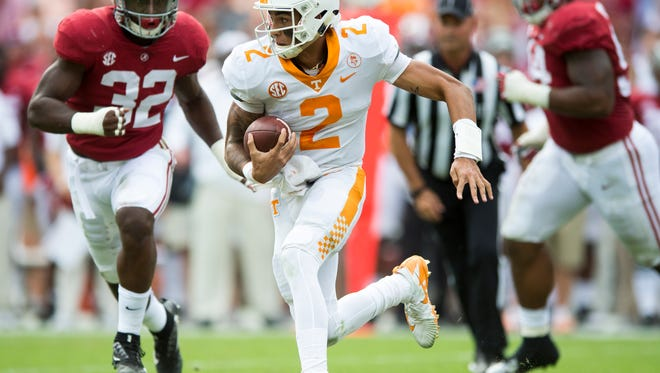 Tennessee quarterback Jarrett Guarantano (2) looks for room to run during Tennessee's game against Alabama at Bryant Denny Stadium in Tuscaloosa on Saturday, Oct. 21, 2017.