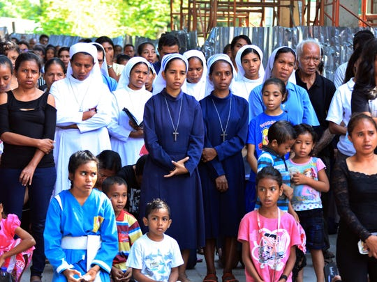East Timorese worshipers are pictured attending a re-enactment