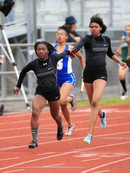 Plymouth's Reghan Draper (left) takes the baton from