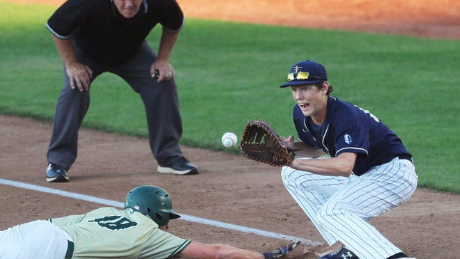 St. Vincent-St. Mary base runner Jake Pentasuglio beats the throw back to first as Hoban first baseman Thomas Crowe eyes down the ball during the fourth inning Saturday at Canal Park in Akron.