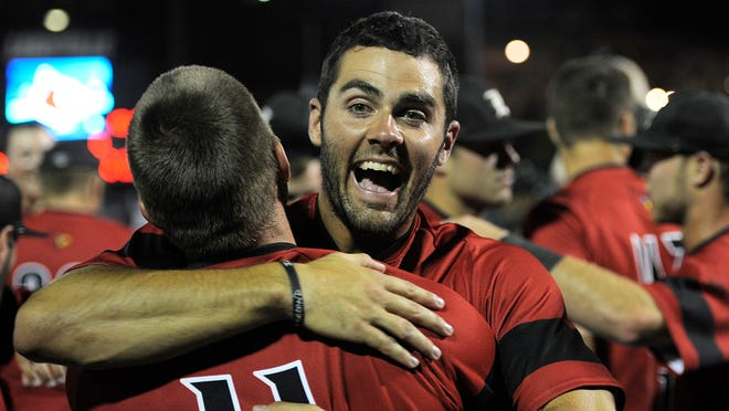 Louisville's Jeff Gardner (right) hugs teammate Zach Lucas as the Cardinals celebrate their win over Kennesaw State on Saturday during the Louisville Super Regional at Jim Patterson Stadium.
