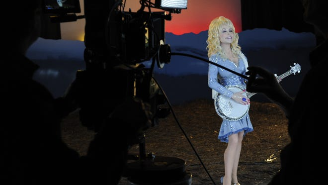"Country music legend Dolly Parton shoots the music video for her song ""Home"" on Thursday in Nashville."