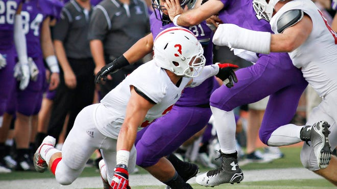 St. John's linebacker Carter Hanson (3) dives on a tackle against St. Thomas in the first half in St. Paul Saturday, Sept. 27.