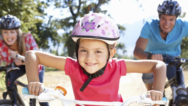 Before your kids ride out of the garage, make sure they haven't forgotten or outgrown their helmets.