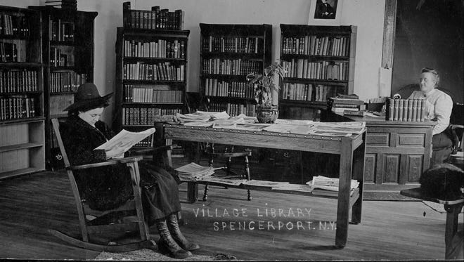 This photo shows the interior of Ogden Public Library when it was housed at Spencerport Village Hall.