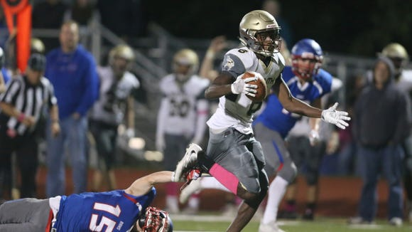 Clarkstown South's Reginald Lamarre (6) breaks free