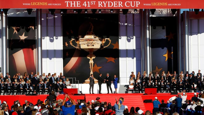 Hosts Dan Hicks (L) and Michele Tafoya (R) speak to captain Davis Love III of the United States and captain Darren Clarke of Europe during the 2016 Ryder Cup Opening Ceremony at Hazeltine National Golf Club.