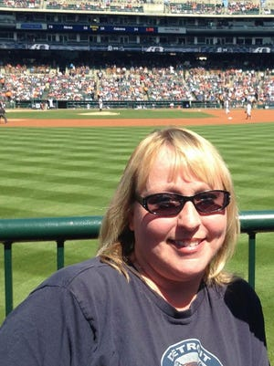 """Breast cancer survivor Shelly Rathbun, pictured at a 2016 Tigers game, will throw out a ceremonial pitch on Mother's Day at Comerica Park. It will also be the Tigers' """"Pink out the Park"""" day to raise breast cancer awareness."""