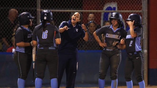 Carroll players and a coach celebrate after Carroll's Lisa Sosa gets a single and an RBI in the ninth inning to go ahead of Gregory-Portland at the Gregory-Portland High School softball field on March 24, 2017.