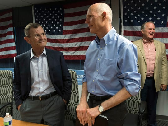 Pete Moore, the owner of Pete Moore Chevrolet, left, chats with Gov. Rick Scott during a campaign stop in Pensacola, Tuesday, April 24, 2018. Scott is running for the U.S. Senator, against the incumbent Sen. Bill Nelson.