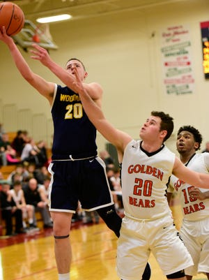 Woodmore's Mitchell Miller worked to become even more of a threat attacking the basket.
