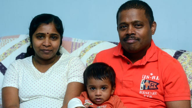 Thavarajah Thiruneelakavdan, his wife  Tharjini  and their 8 month-old son Keerthikan call York their home after moving here from Sri Lanka.  (John A. Pavoncello - The York Dispatch)