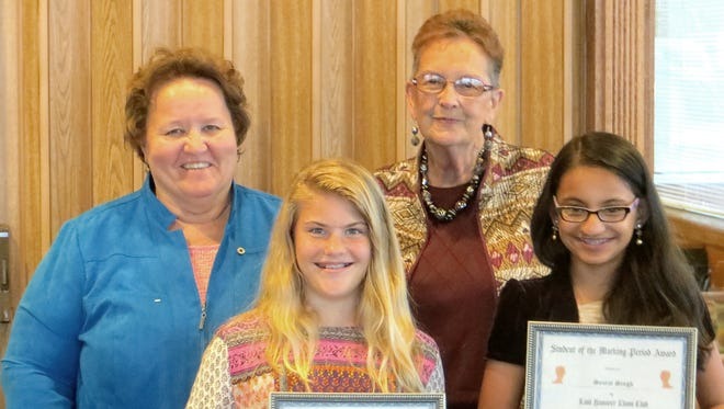 The East Hanover Lions Club honored the Elementary Students of the Third Marking Period at its recent dinner meeting. Pictured are, front from left, Miranda Ulrey of East Hanover Elementary School in Dauphin County and Searat Singh of East Hanover Elementary School in Lebanon County, and back row from left, Nancy Gamber and Molly Gumpher, chairwomen of the club's committee. The students received certificates, large Hershey candy bars and a cash award.
