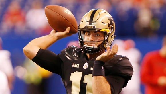 Purdue quarterback David Blough warms up before the