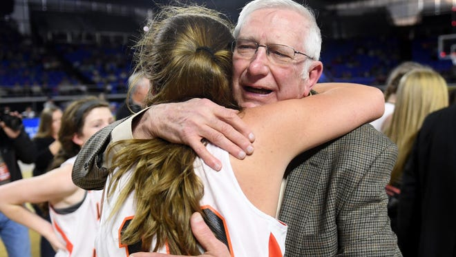 Greenfield assistant coach Don Durden gives Greenfield's Tess Darby a hug at the end of the the 2018 Class A Championship game, Saturday, March 10, in Murfreesboro. Greenfield defeated Summertown, 47-39, to become the 2018 Class A Champions.